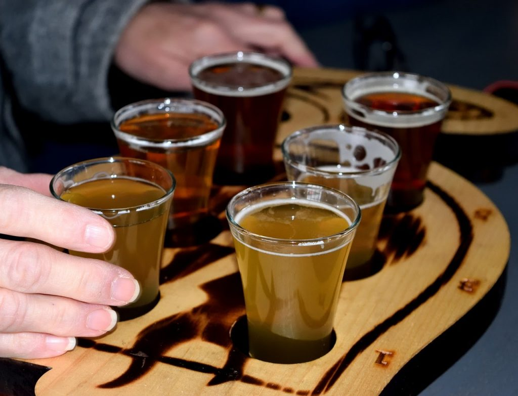 Different craft beers on tray