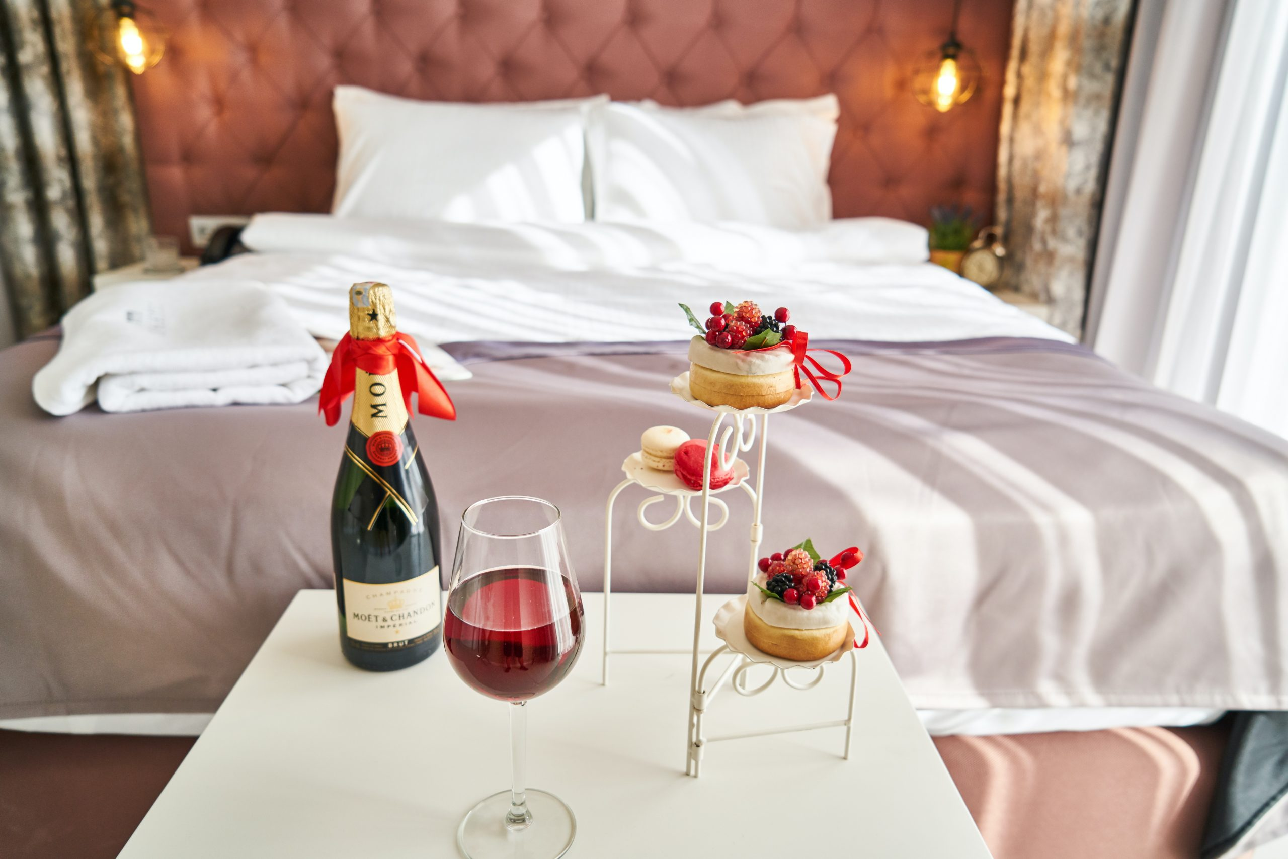 hotel room with wine and pastries