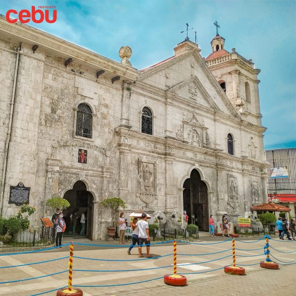 People walking in front of the Basilica's facade